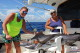 Girl catch blue marlin deep sea fishinig Bavro Punta Cana Dominican fisherman